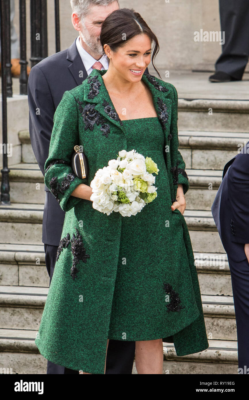 LONDON, UK - March 11: Meghan Markle and Prince Harry receive flowers after leaving Canada House in London, UK Credit: Mr Pics/Alamy Live News Stock Photo