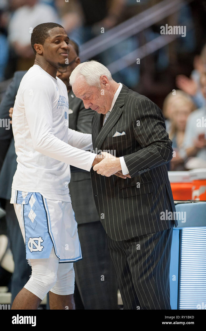 March 9, 2019 - Chapel Hill, North Carolina; USA - North Carolina Tar Heels Head Coach ROY WILLIAMS speaks with Tar Heel (20) KENNY WILLIAMS during Senior introductions as the University of North Carolina Tar Heels defeated the Duke Blue Devils with a final score of 79-70 as they played mens college basketball at the Dean Smith Center located in Chapel Hill. Copyright 2019 Jason Moore. Credit: Jason Moore/ZUMA Wire/Alamy Live News Stock Photo