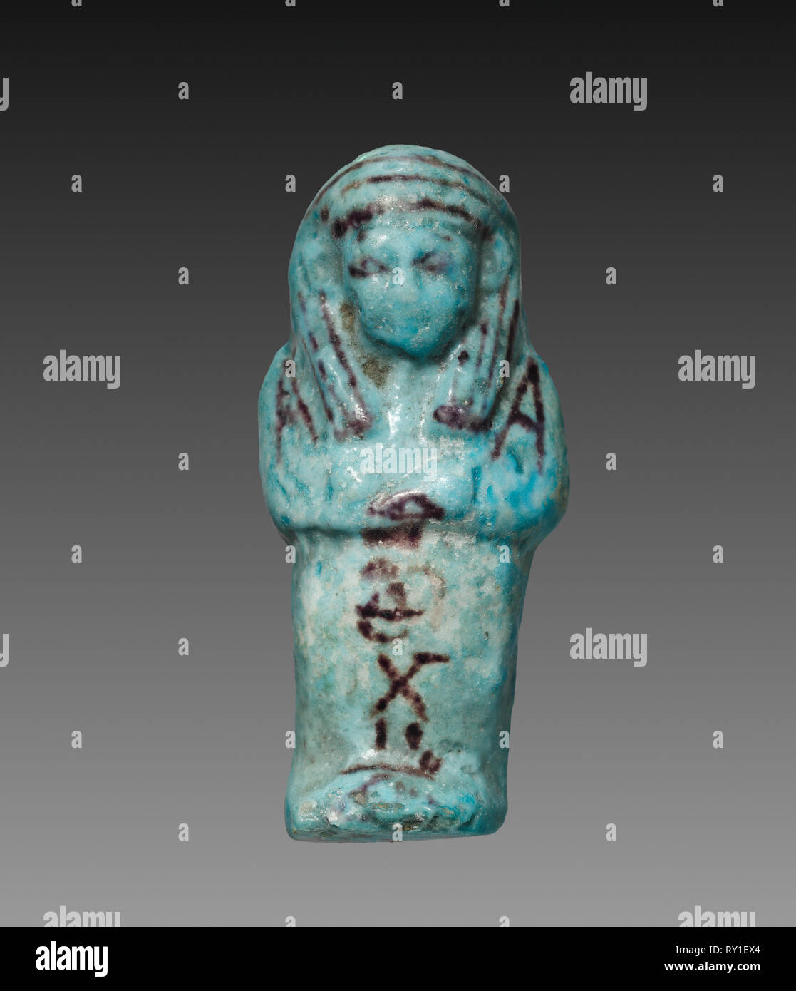 Shawabty of Payefadjer, 1000-945 BC. Egypt, Third Intermediate Period, late Dynasty 21 (1096-945 BC). Turquoise faience with purple decoration; overall: 9.2 x 4.1 x 2.4 cm (3 5/8 x 1 5/8 x 15/16 in - Stock Image