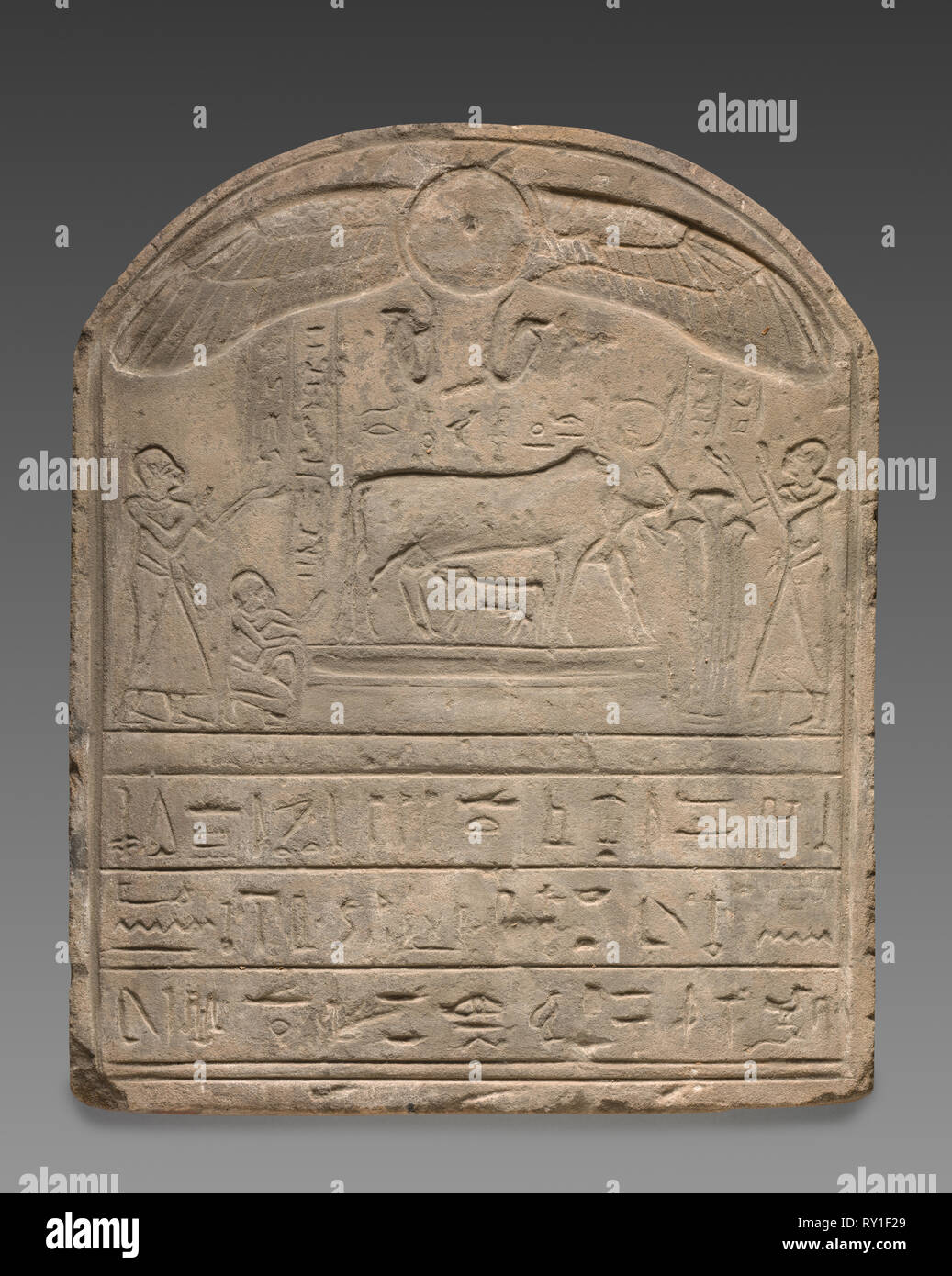 Round-Topped Stele, 332 BC-AD 395. Egypt, Greco-Roman Period or modern forgery. Sandstone; diameter: 9.5 cm (3 3/4 in.); overall: 57.4 x 46.3 x 11 cm (22 5/8 x 18 1/4 x 4 5/16 in - Stock Image