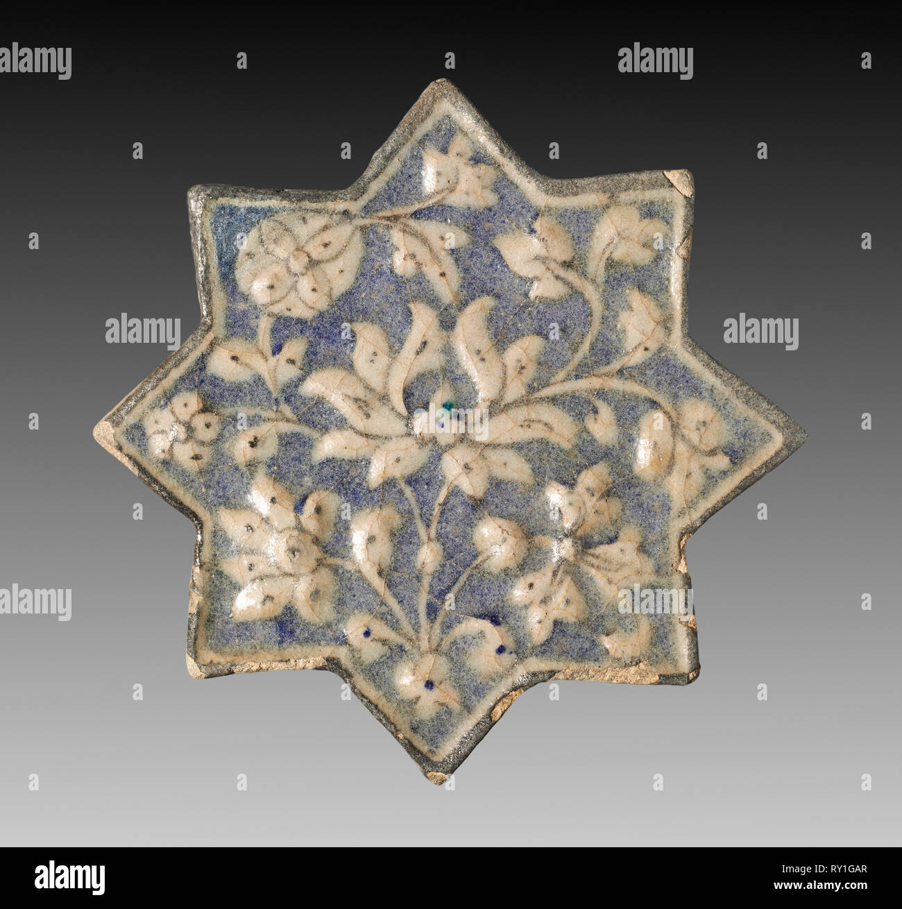 Wall Tile with Lotus Blossom, c. 1300-1350. Iran, probably Sultanabad. Fritware with molded and underglaze-painted design; overall: 20 x 20 cm (7 7/8 x 7 7/8 in - Stock Image