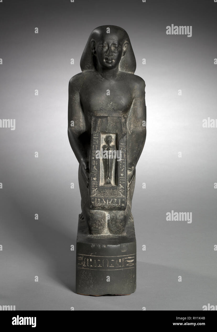 Naophorous Statue of the Finance Officer and Overseer of Fields, Horwedja, 521-486 BC. Egypt, Late Period, Dynasty 27, probably reign of Darius I. Graywacke; overall: 43 x 14.2 x 23.2 cm (16 15/16 x 5 9/16 x 9 1/8 in - Stock Image