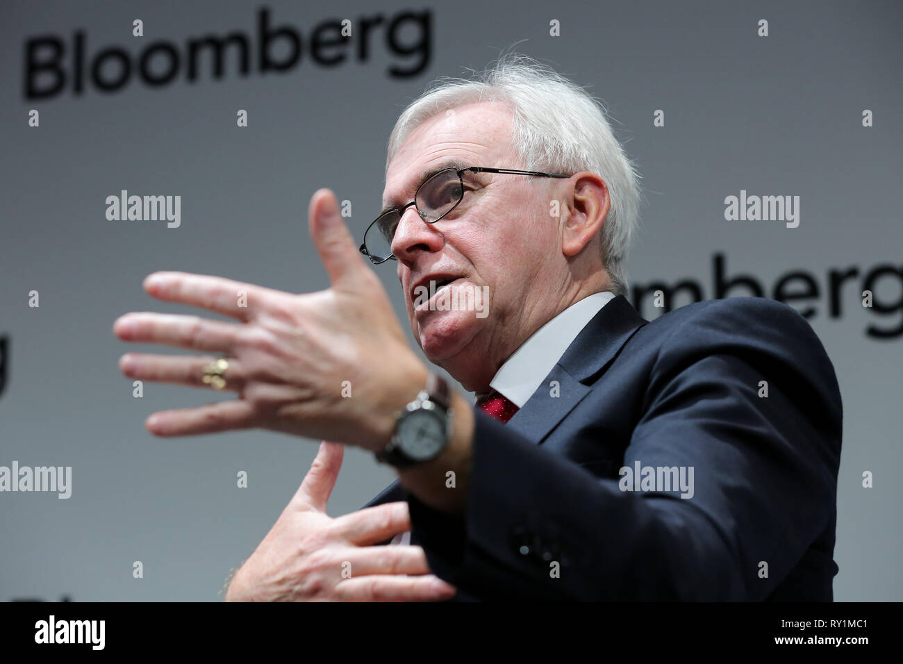 Shadow Chancellor John McDonnell MP is seen attending the business leaders' event as a guest speaker at Bloomberg Headquarters in London ahead of Chancellor Philip Hammond's Spring Statement later this week. - Stock Image