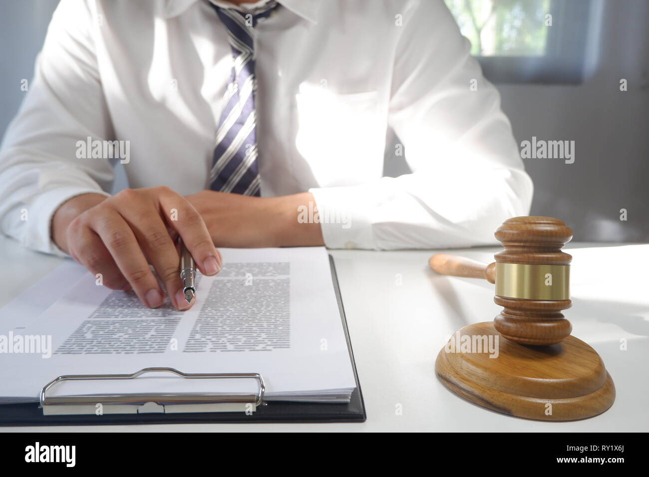 Legal counsel presents a contract with gavel and legal law. justice and lawyer concept Stock Photo