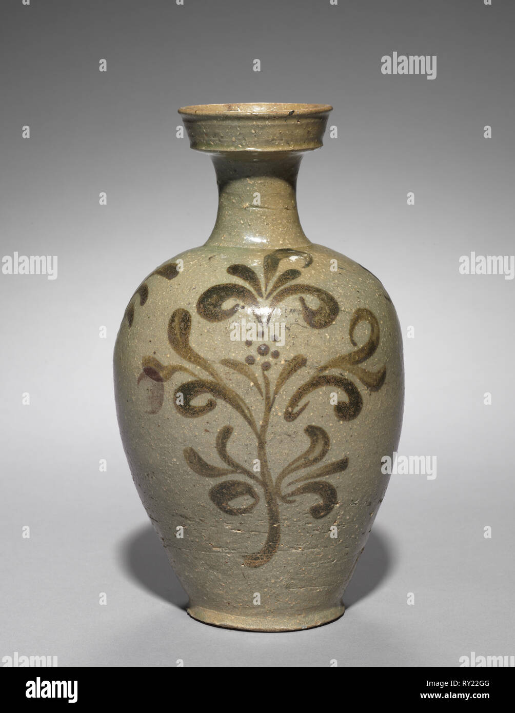 Vase with Floral Design, 1100s. Korea, Goryeo period (918-1392). Celadon with underglaze iron-brown; overall: 26.4 cm (10 3/8 in - Stock Image