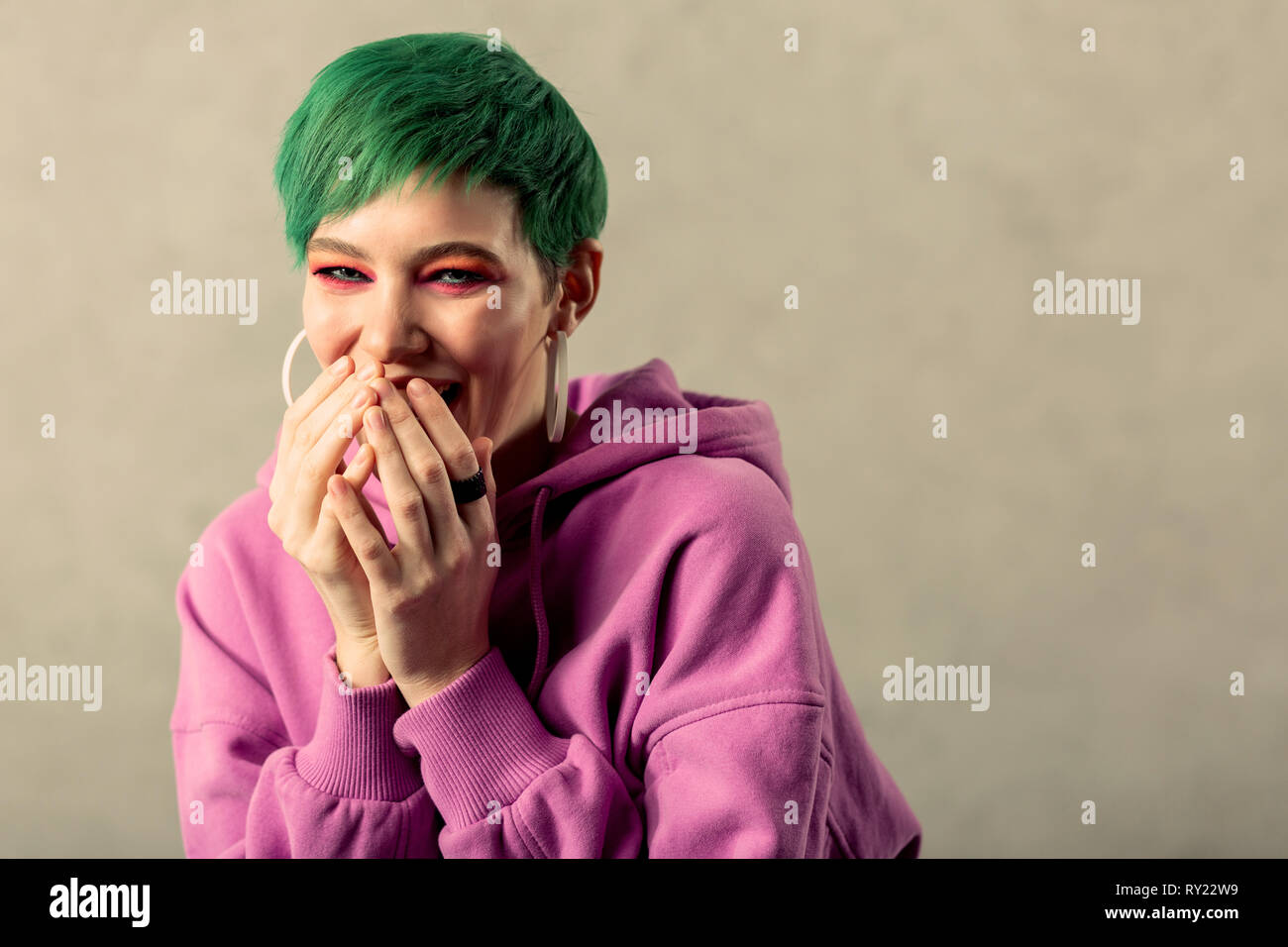 Portrait of a happy green haired woman - Stock Image