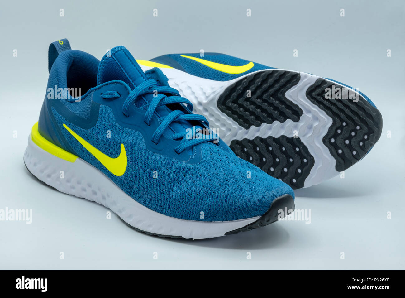 3162ef72 Blue Nike Odyssey React running shoes cut out isolated on white background  - Stock Image