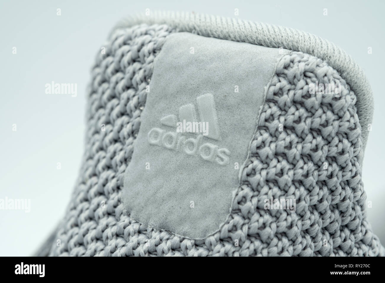 Adidas logo on the tongue of an UltraBoost running shoe - Stock Image