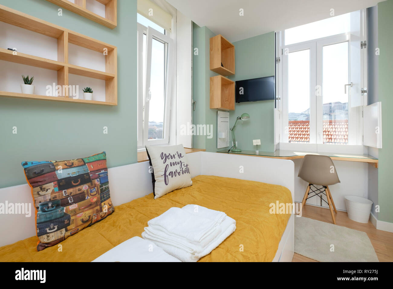Colorfully decorated small apartment bedroom with single bed ...