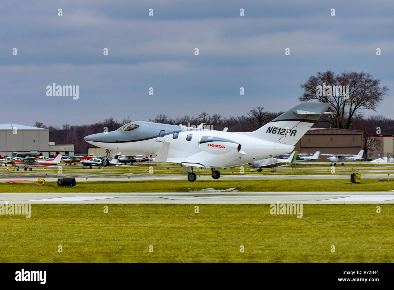Wheeling, Illinois, United States - March 10, 2019: Honda Jet HA-420 small business jet landing at the Chicago Executive Airport in Wheeling, IL. - Stock Image