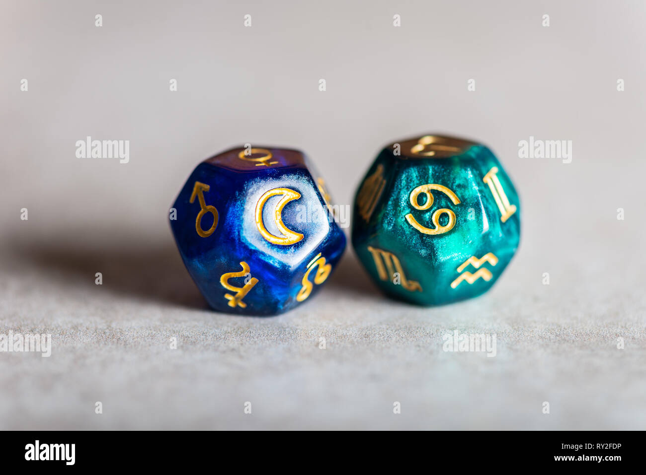 Astrology Dice with zodiac symbol of Cancer and its ruling celestial body the Moon Stock Photo