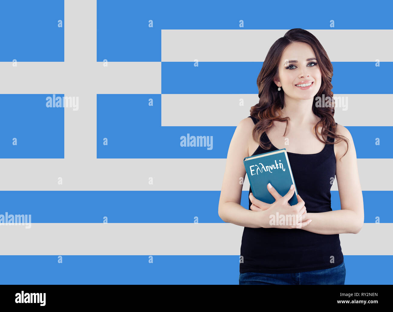 Greece and greek language concept. Smiling girl with book and Greek flag - Stock Image