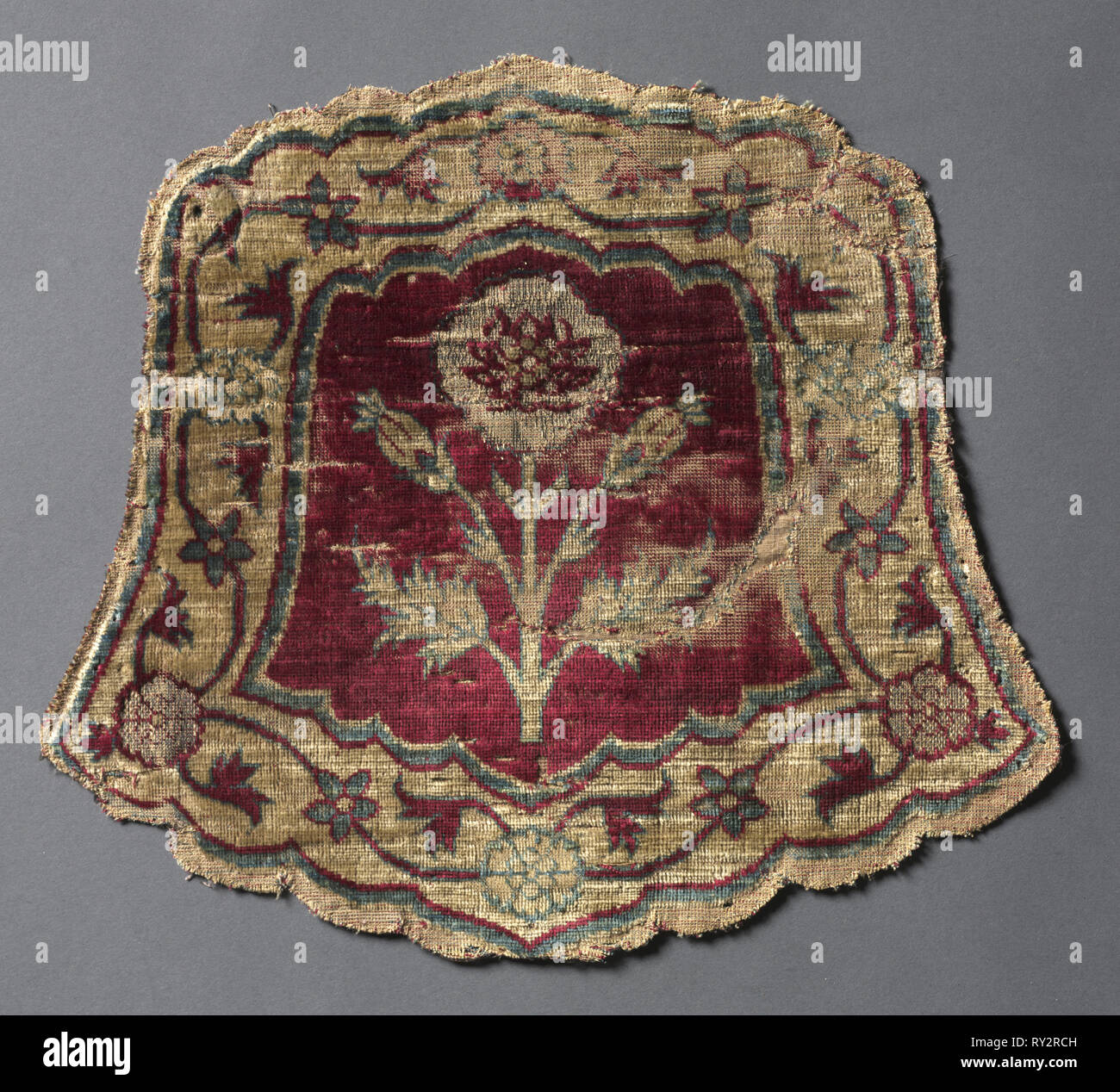 Shaped horse trapping, 1600s. India. Velvet, brocaded and pile warp substitution: silk and gilt-metal thread; average: 26.1 x 23.5 cm (10 1/4 x 9 1/4 in - Stock Image