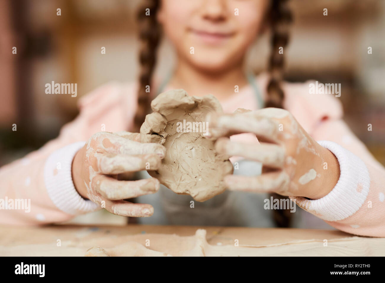 Litle Girl Shaping Clay - Stock Image