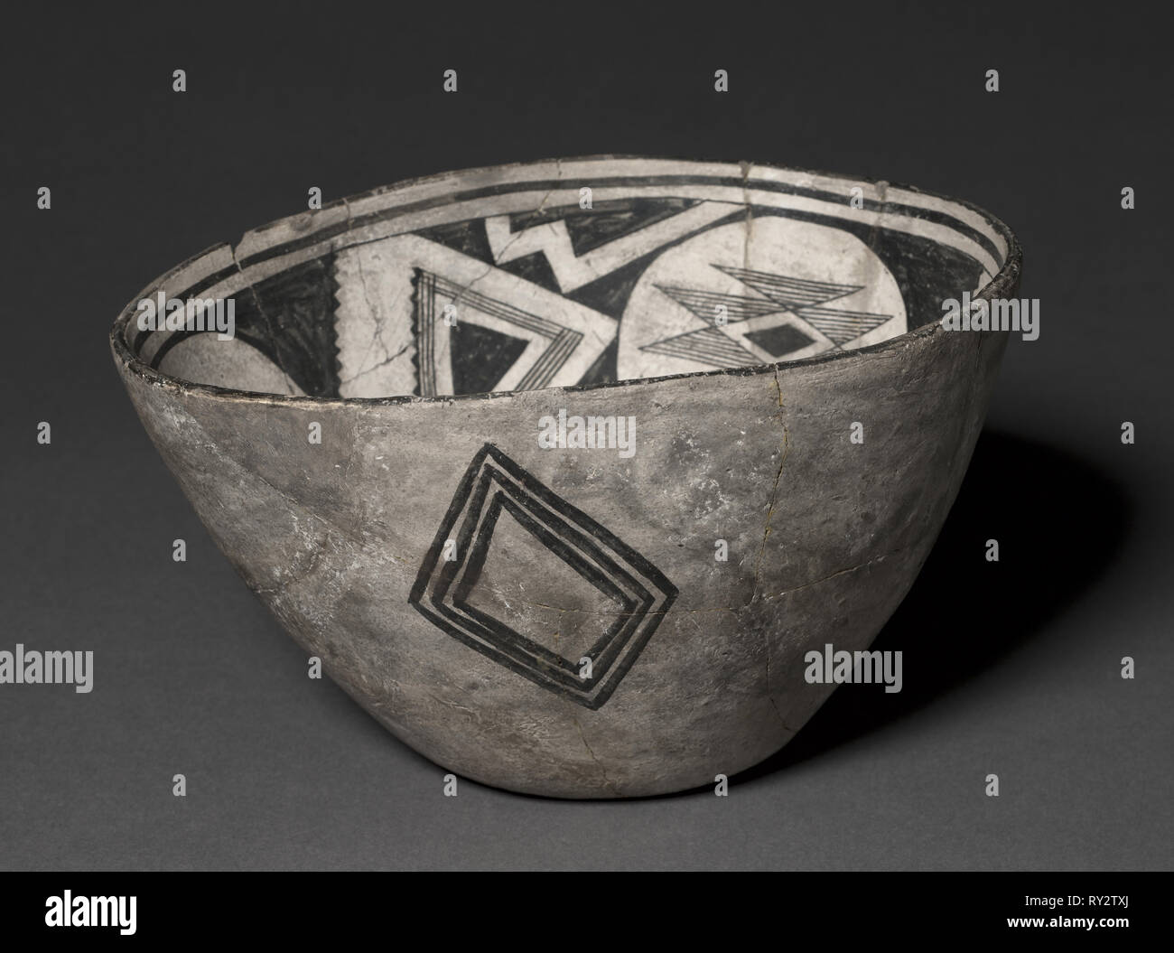 Bowl with Geometeric Design, Warped (Three-part Design), c 1000- 1150. Southwest,Mogollan, Mimbres, Pre-Contact Period, 11th-12th century. Ceramic; overall: 15.5 x 24 cm (6 1/8 x 9 7/16 in Stock Photo