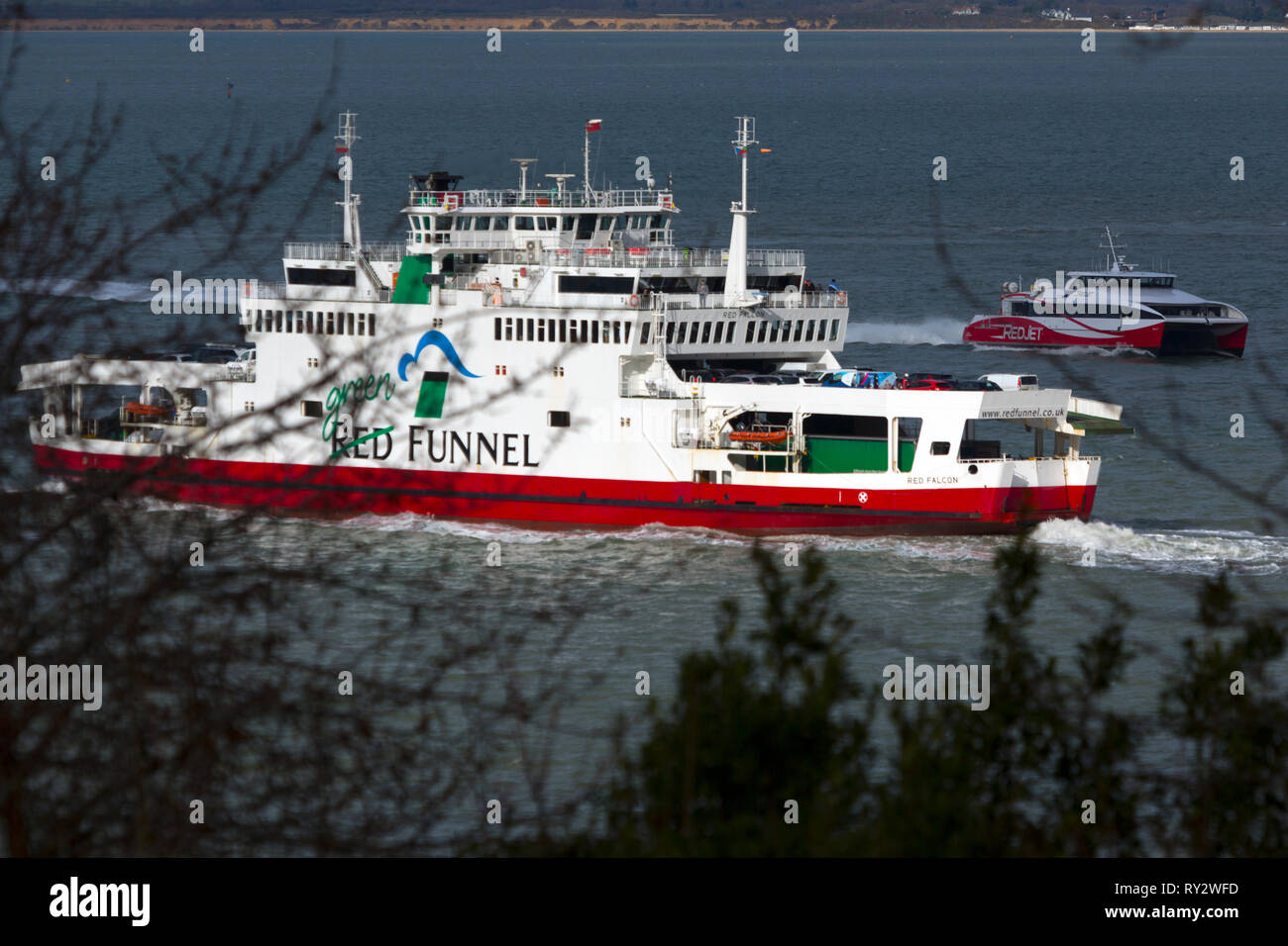 Red,Funnel,fast,passenger,car,ferry,green,deal,campaign,Cowes,Isle of Wight,England,UK, - Stock Image