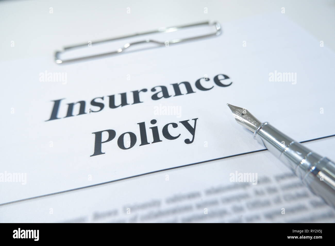 insurance policy form and pen on desk in office showing risk concept. Life; Health, car, travel insurance concept. - Stock Image