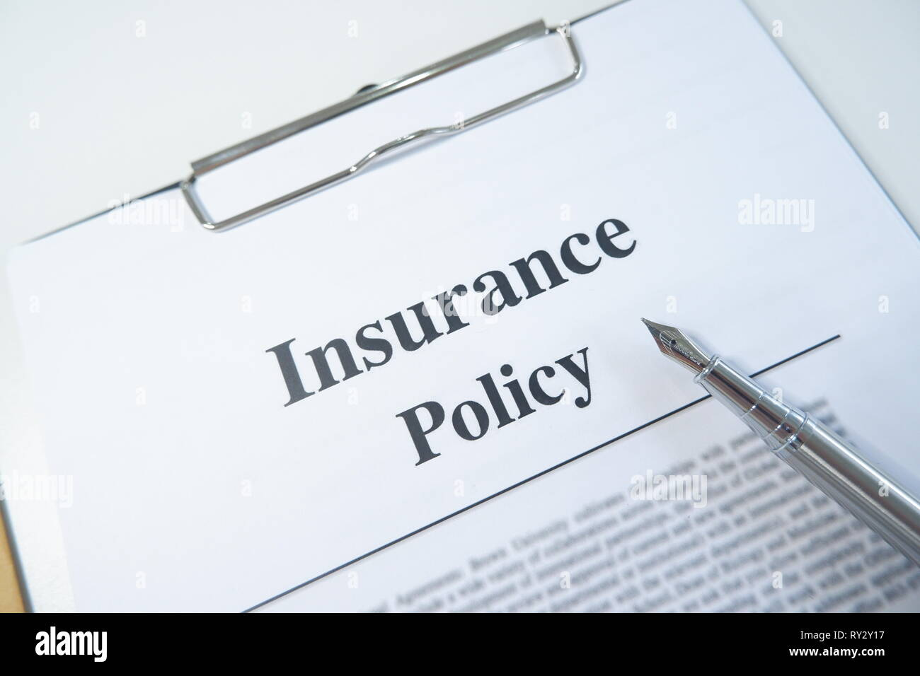 insurance policy form and pen on desk in office showing risk concept. Life; Health, car, travel - Stock Image