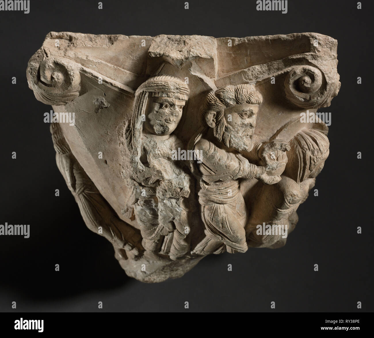 Fragment of a Capital with Scenes from Mary's Infancy, early 1100s. Workshop of The Cathedral of Monopoli (Italian). Fine-grained limestone; without base: 26.7 x 33 x 22.9 cm (10 1/2 x 13 x 9 in - Stock Image