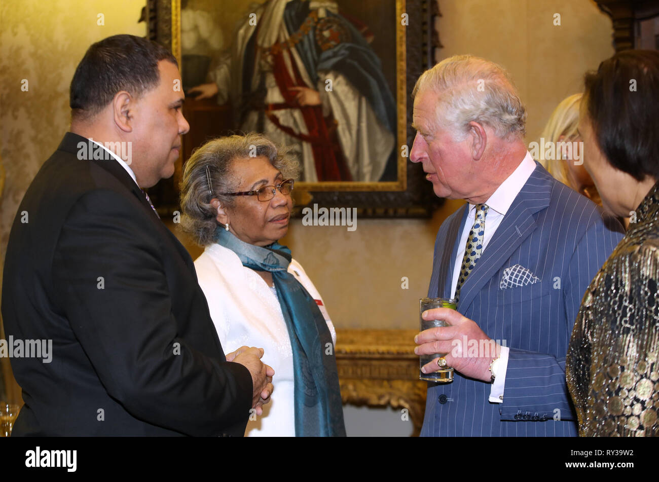 Prince of Wales (right) speaks with guests at the annual Commonwealth Day reception at Marlborough House, the home of the Commonwealth Secretariat in London. Stock Photo