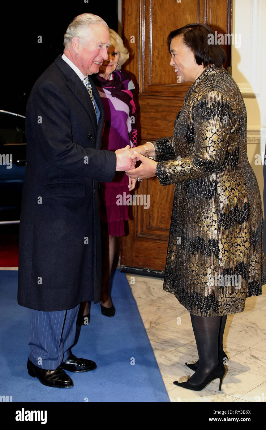 The Prince of Wales the Duchess of Cornwall are greeted by Commonwealth Secretary-General Patricia Scotland at the annual Commonwealth Day reception at Marlborough House, the home of the Commonwealth Secretariat in London. Stock Photo