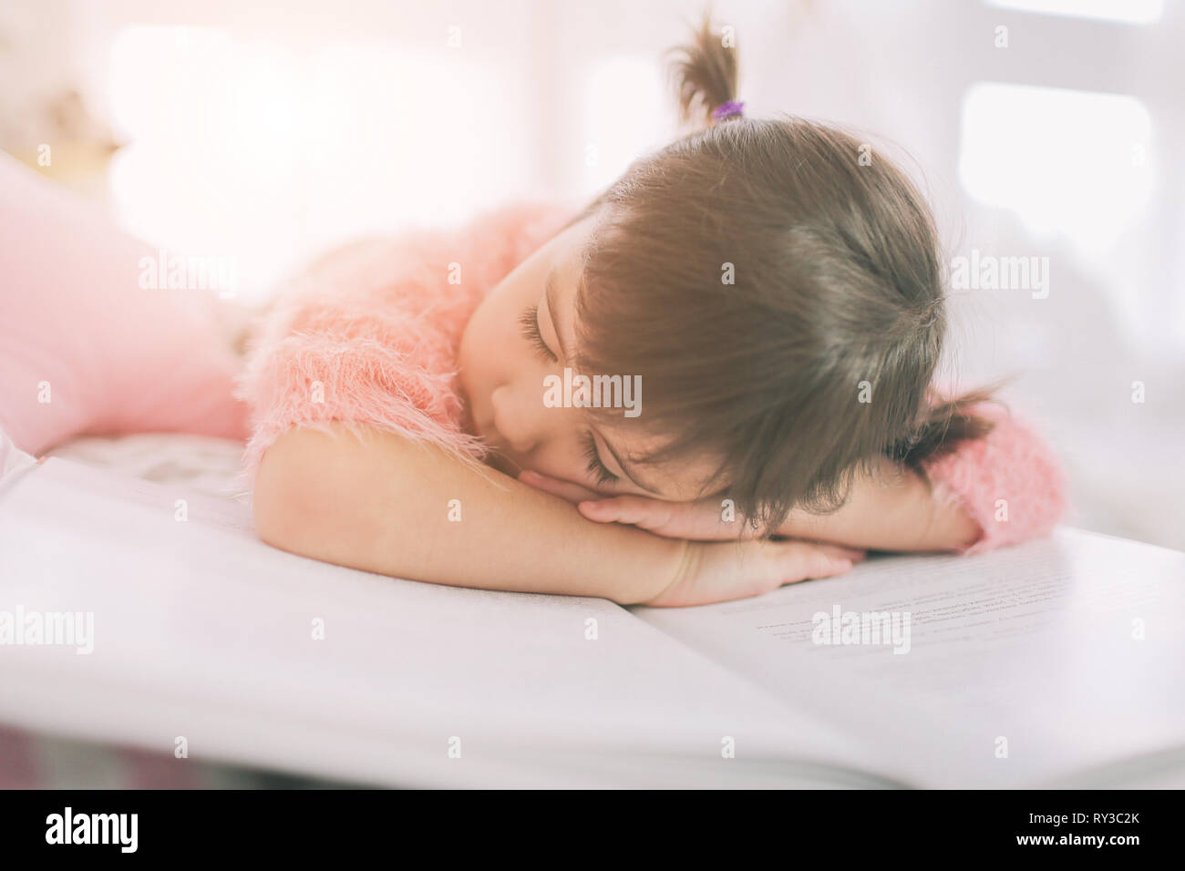 Cute Little Kid Girl Is Reading A Book At Home Funny Lovely