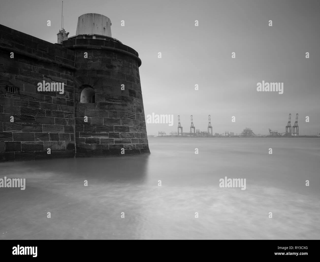 Fort Perch Rock in New Brighton was built in 1825. This shot is looking over to Liverpool dockyards. - Stock Image