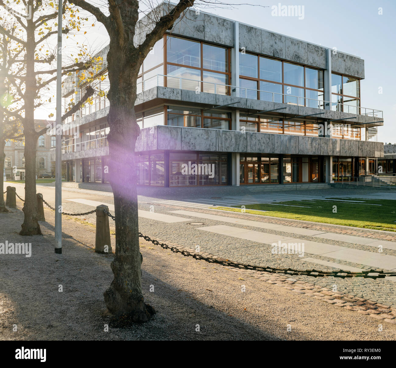 Karlsruhe, Germany - Oct 29 2017: Sunlight over empty alley in front of Federal Constitutional Court building Bundesverfassungsgericht the supreme court for of Germany - Stock Image
