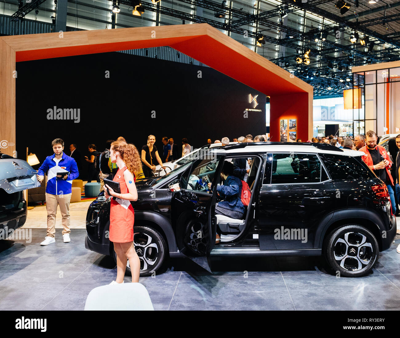 PARIS, FRANCE - OCT 4, 2018: Customers and curious people admiring the new Hybrid Citroen SUV family car at International car exhibition Mondial Paris Motor Show, model produced by French  car maker - Stock Image