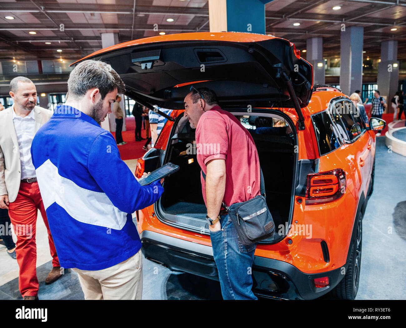 PARIS, FRANCE - OCT 4, 2018: Customers and curious people admiring the new  at International car exhibition Mondial Paris Motor Show, model produced by  car maker - Stock Image
