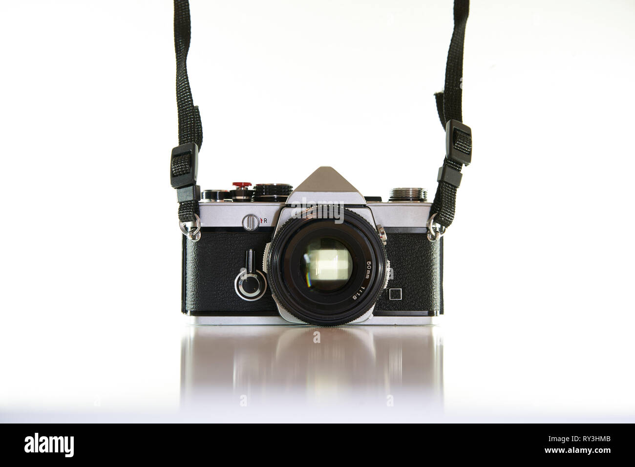 London, UK - August, 2018. Vintage film slr camera with a white background. - Stock Image