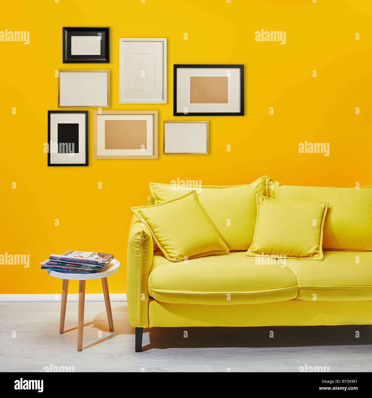coffee table standing near modern yellow sofa near ...