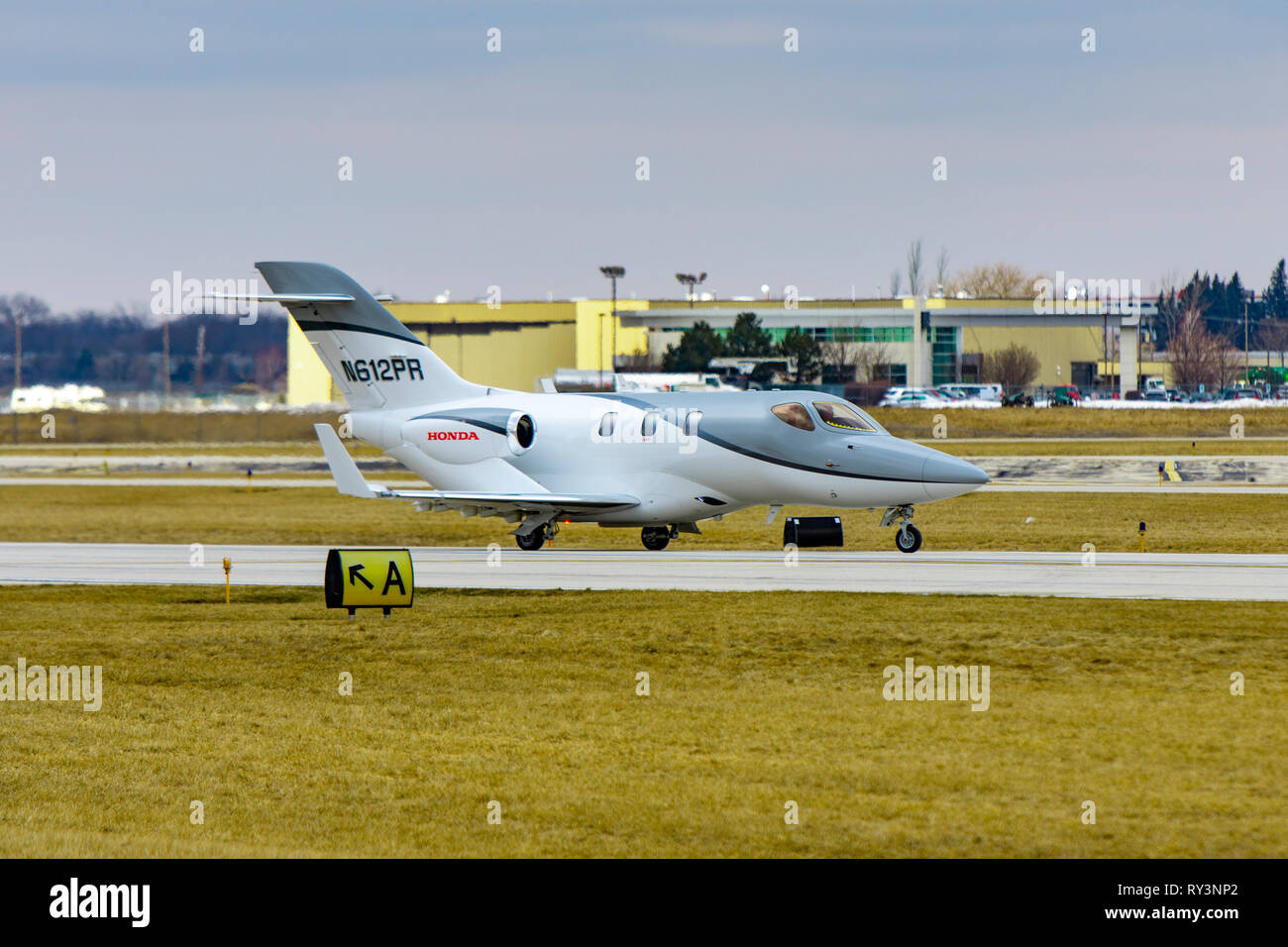Wheeling, Illinois, United States - March 10, 2019: Honda Jet HA-420 small business jet taxiing after landing. - Stock Image