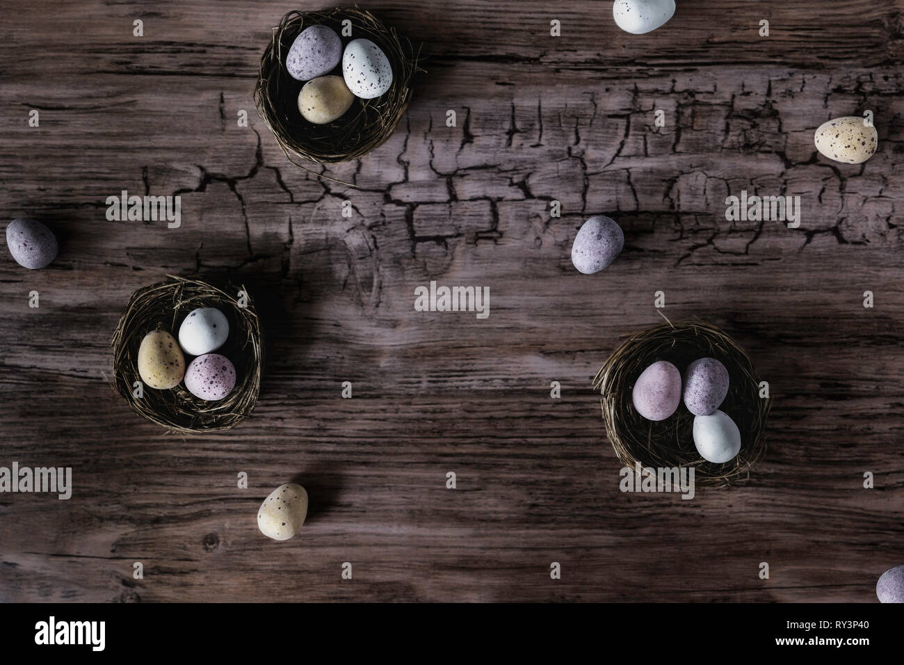 Looking down on chocolate Easter eggs laid out in nests Stock Photo
