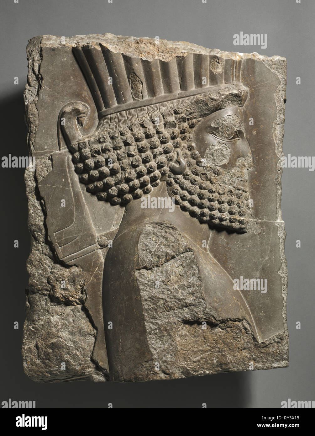 Fragment of a Wall Decoration from the Palace of Xerxes: 'Guardsman' in Procession, 486-465 BC. Achaemenid, Iran, Persepolis, 5th Century BC. Gray limestone; overall: 53 x 43.6 cm (20 7/8 x 17 3/16 in - Stock Image