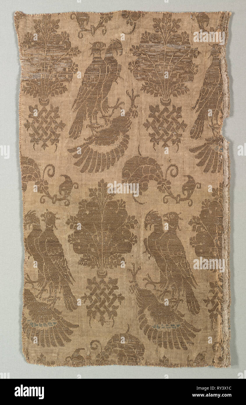 Gold-patterned Silk with Falcons and Heraldry, 1360-1400. Italy, last third of 14th century. Silk, gold thread; a combination of two weaves (lampas); overall: 40 x 24.5 cm (15 3/4 x 9 5/8 in - Stock Image