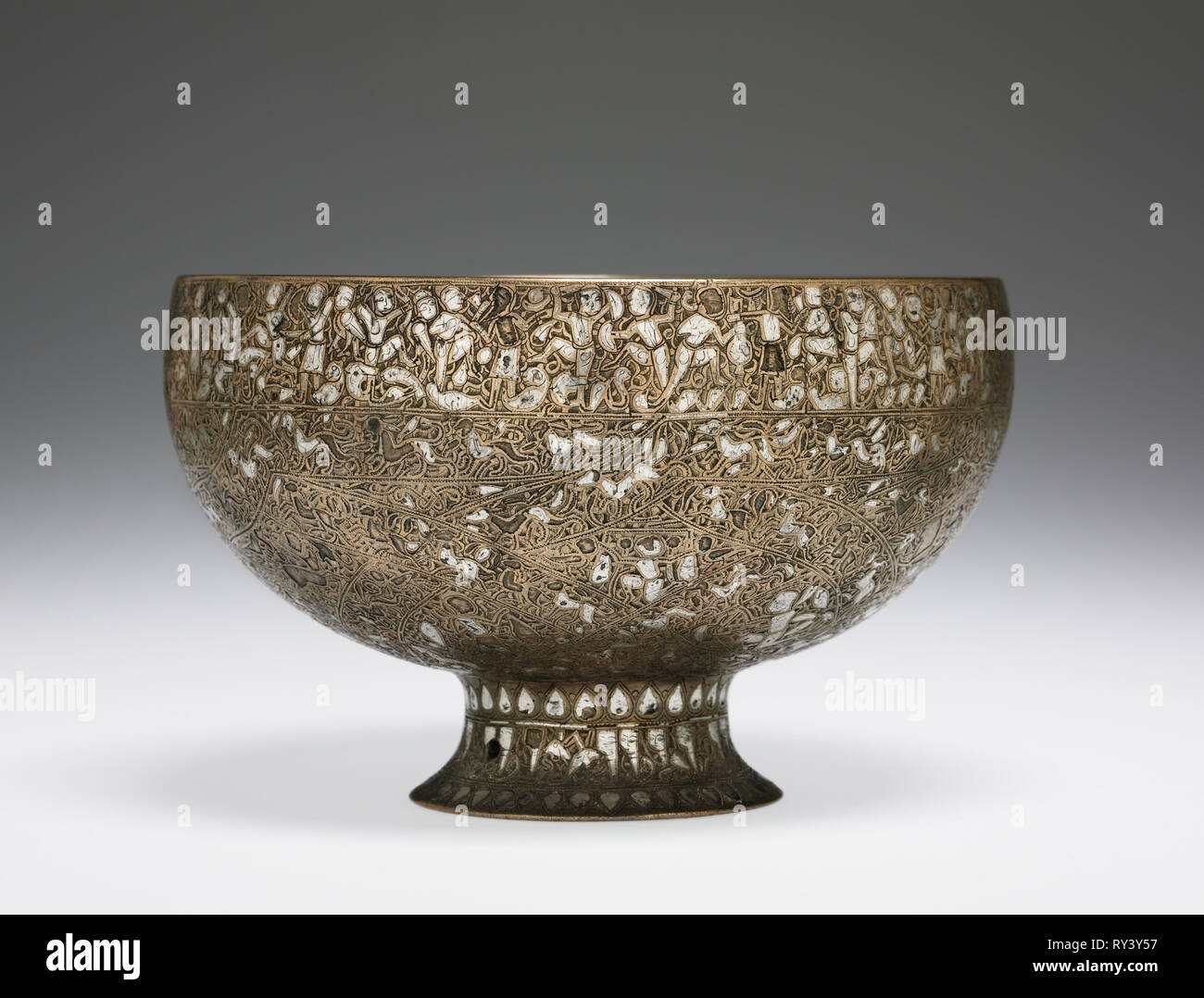 The Wade Cup with Animated Script, 1200-1221. Iran, Seljuk Period, 13th Century. Brass inlaid with silver; diameter: 16.1 cm (6 5/16 in.); overall: 11.5 cm (4 1/2 in - Stock Image