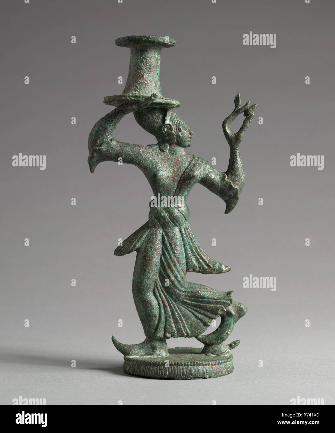 Candelabrum Stand of a Dancing Maenad, 525-500 BC. Italy, Etruscan, late 6th Century BC. Bronze; overall: 18.8 cm (7 3/8 in Stock Photo