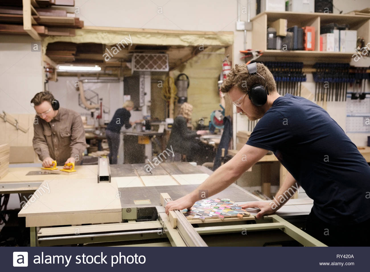 Artists woodworking in workshop - Stock Image