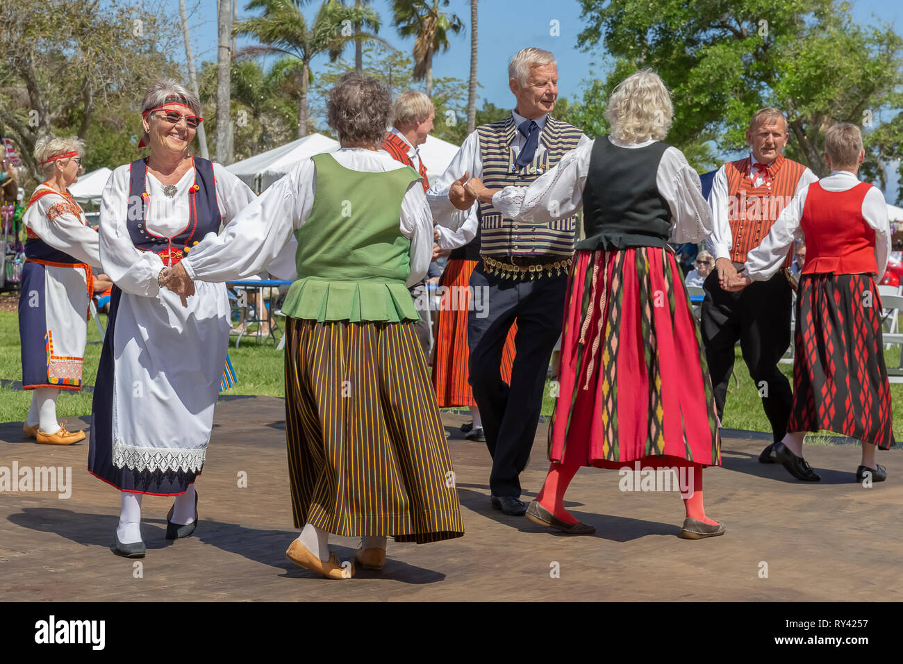 Lake Worth, Florida, USA March 3, 2019 Midnight Sun Festival Celebrating Finnish Culture. The men are coupled with women while two ladies are coupled. - Stock Image
