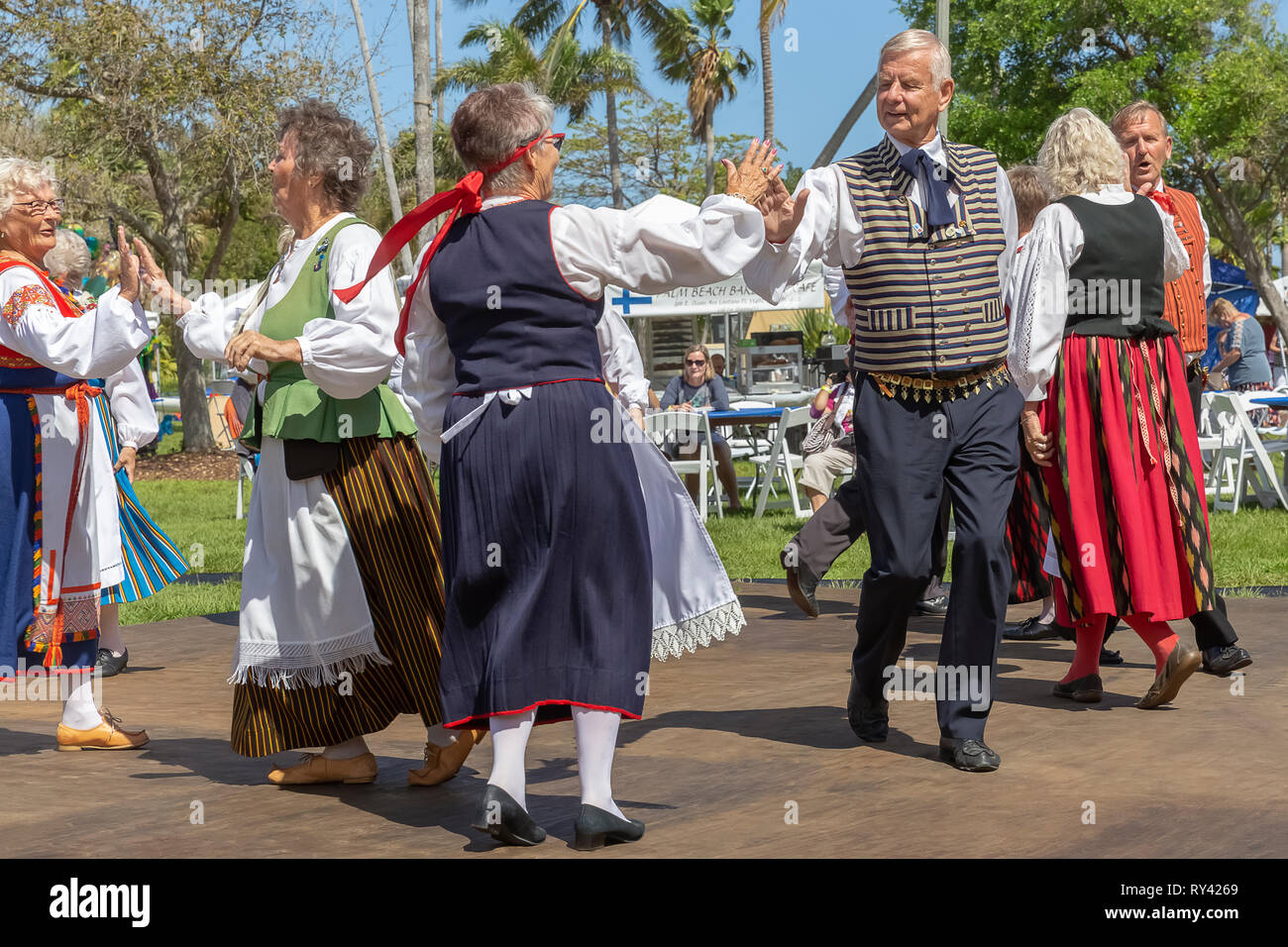 Lake Worth, Florida, USA March 3, 2019,​ Midnight Sun Festival Celebrating Finnish Culture. The couples go round and round each other while dancing. - Stock Image