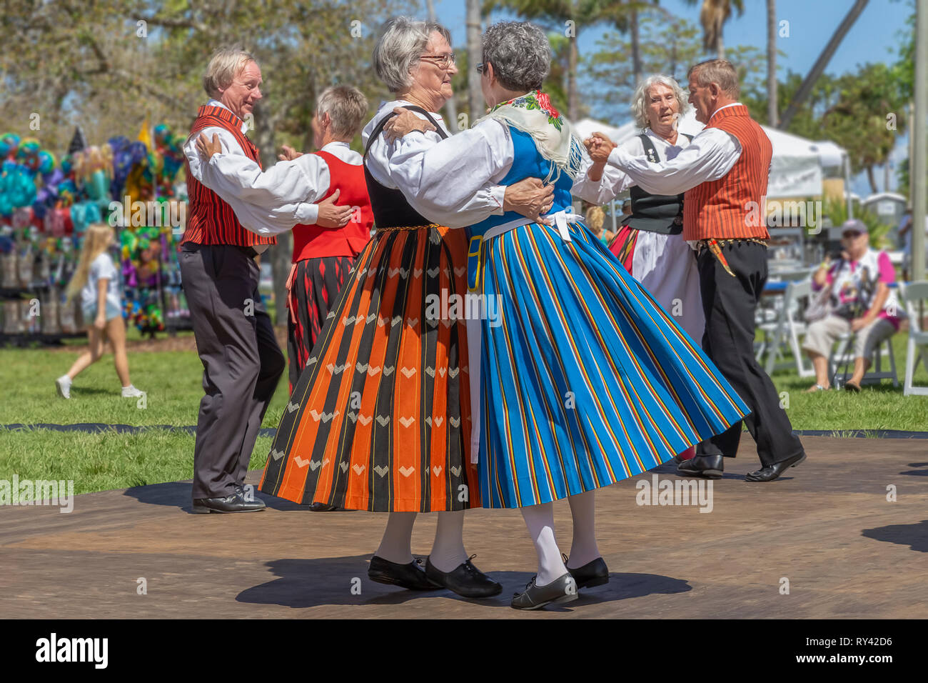 Lake Worth, Florida, USA March 3, 2019,​ Midnight Sun Festival Celebrating Finnish Culture. Two women dance together dressed in Finnish costume. - Stock Image