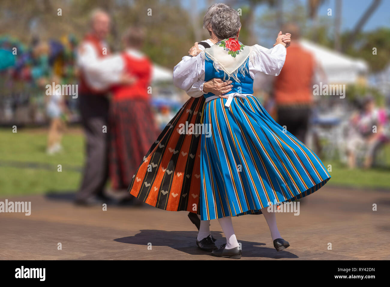 Lake Worth, Florida, USA March 3, 2019,​ Midnight Sun Festival Celebrating Finnish Culture. Two women wearing long beautiful Finnish dresses dancing. - Stock Image