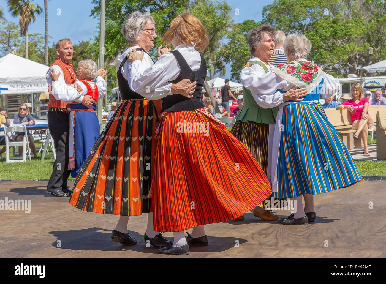 Lake Worth, Florida, USA March 3, 2019,​ Midnight Sun Festival Celebrating Finnish Culture. Women couples are dressed in traditional Finnish clothing. - Stock Image