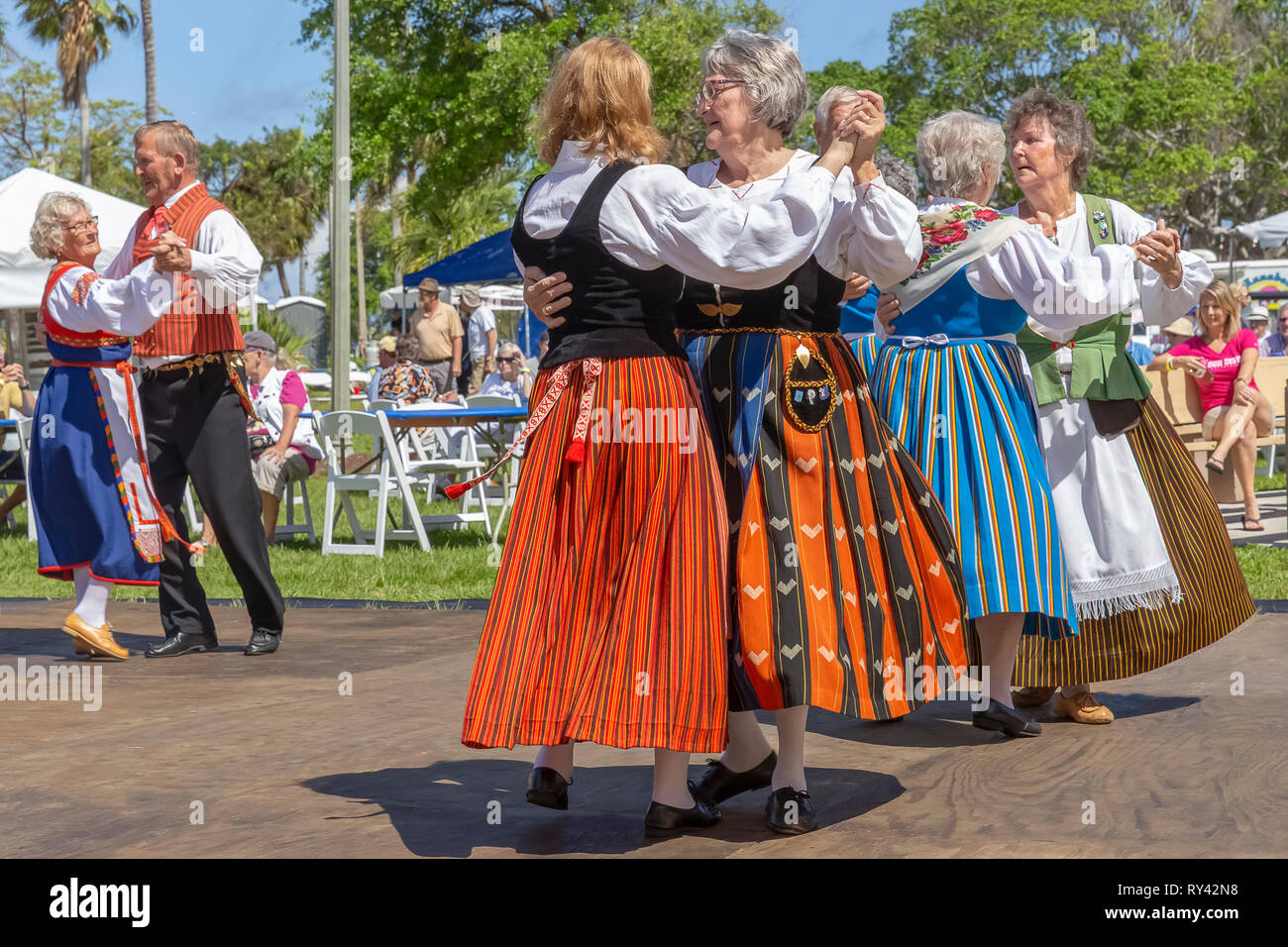 Lake Worth, Florida, USA March 3, 2019 Midnight Sun Festival Celebrating Finnish Culture. Women couples dancing together with traditional couples. - Stock Image