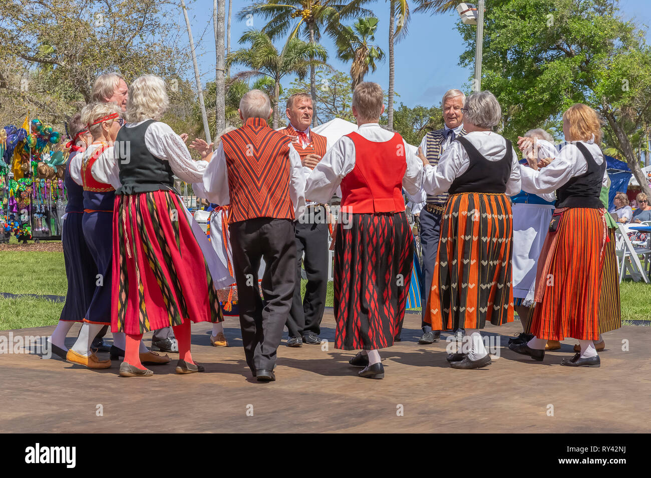 Lake Worth, Florida, USA March 3, 2019,​ Midnight Sun Festival Celebrating Finnish Culture. Mature couples dancing together in a tight circle. - Stock Image