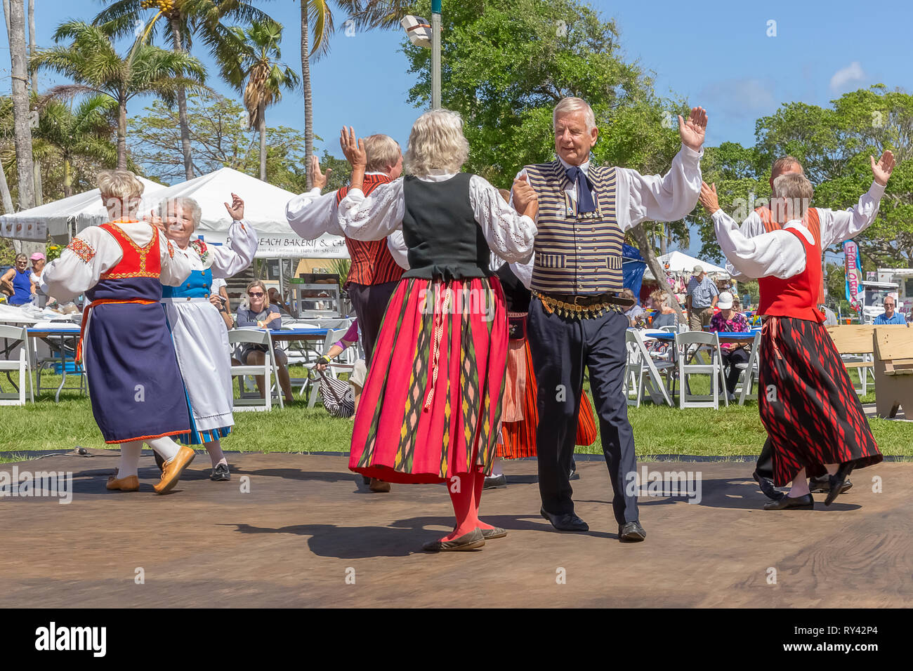 Lake Worth, FL, USA March 3, 2019, Midnight Sun Festival Celebrating Finnish Culture. The couples hold each other's right hand up and left hand up. - Stock Image