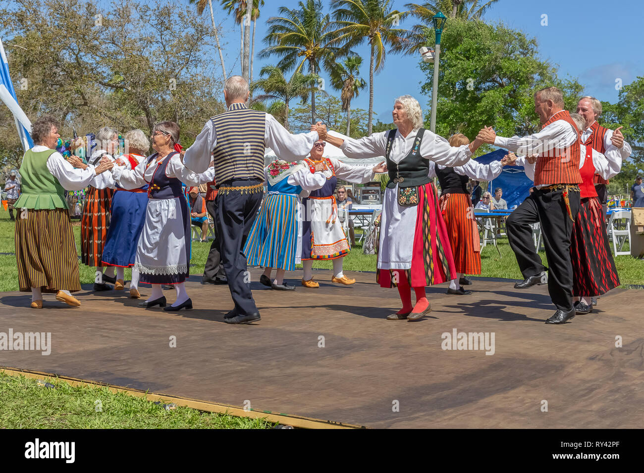 Lake Worth, Florida, USA March 3, 2019, Midnight Sun Festival Celebrating Finnish Culture. The couples hold hands as they around and around. - Stock Image