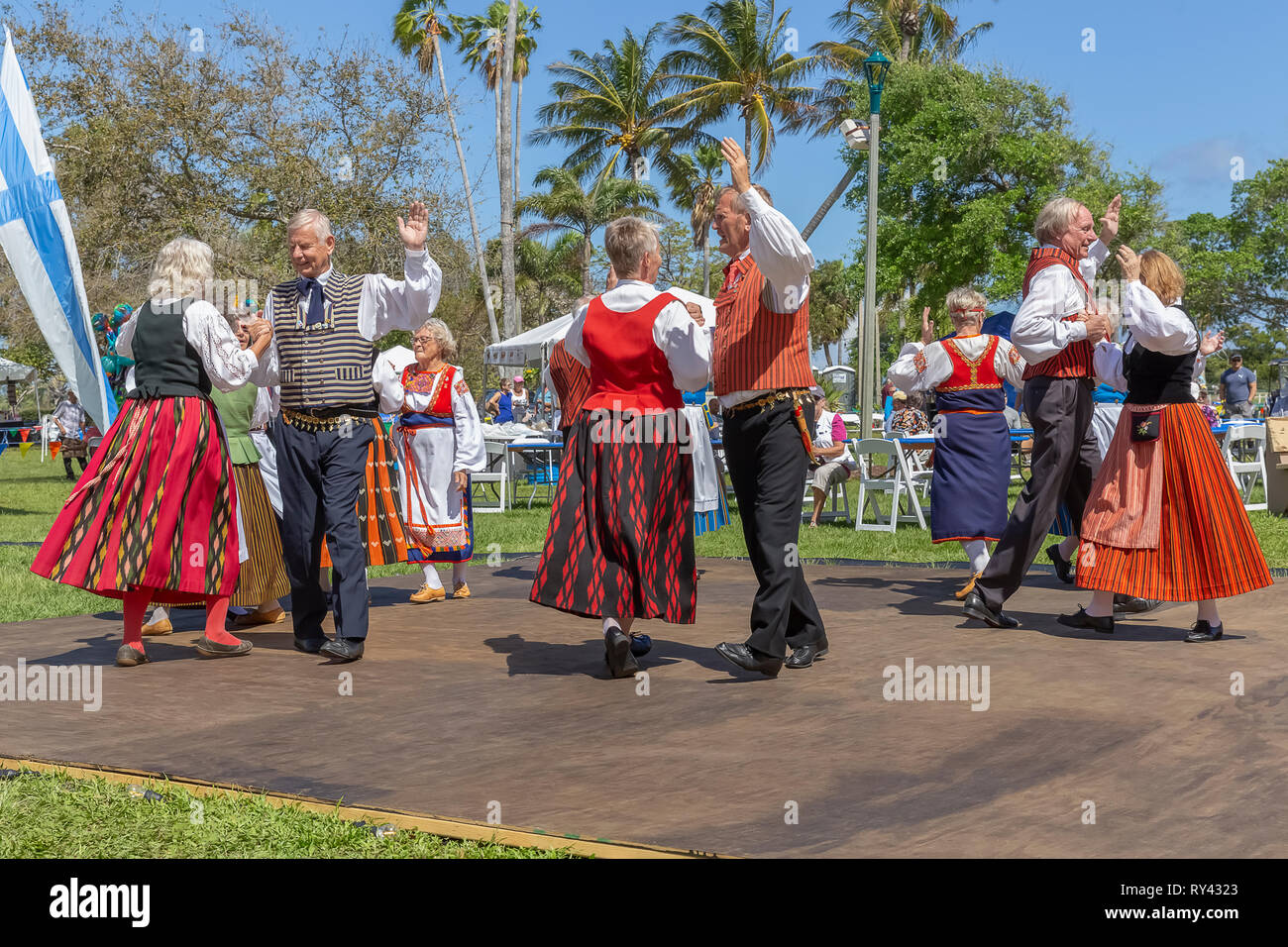 Lake Worth, Florida, USA March 3, 2019, Midnight Sun Festival Celebrating Finnish Culture. The couples dance in partnership on an outdoor dance floor. - Stock Image