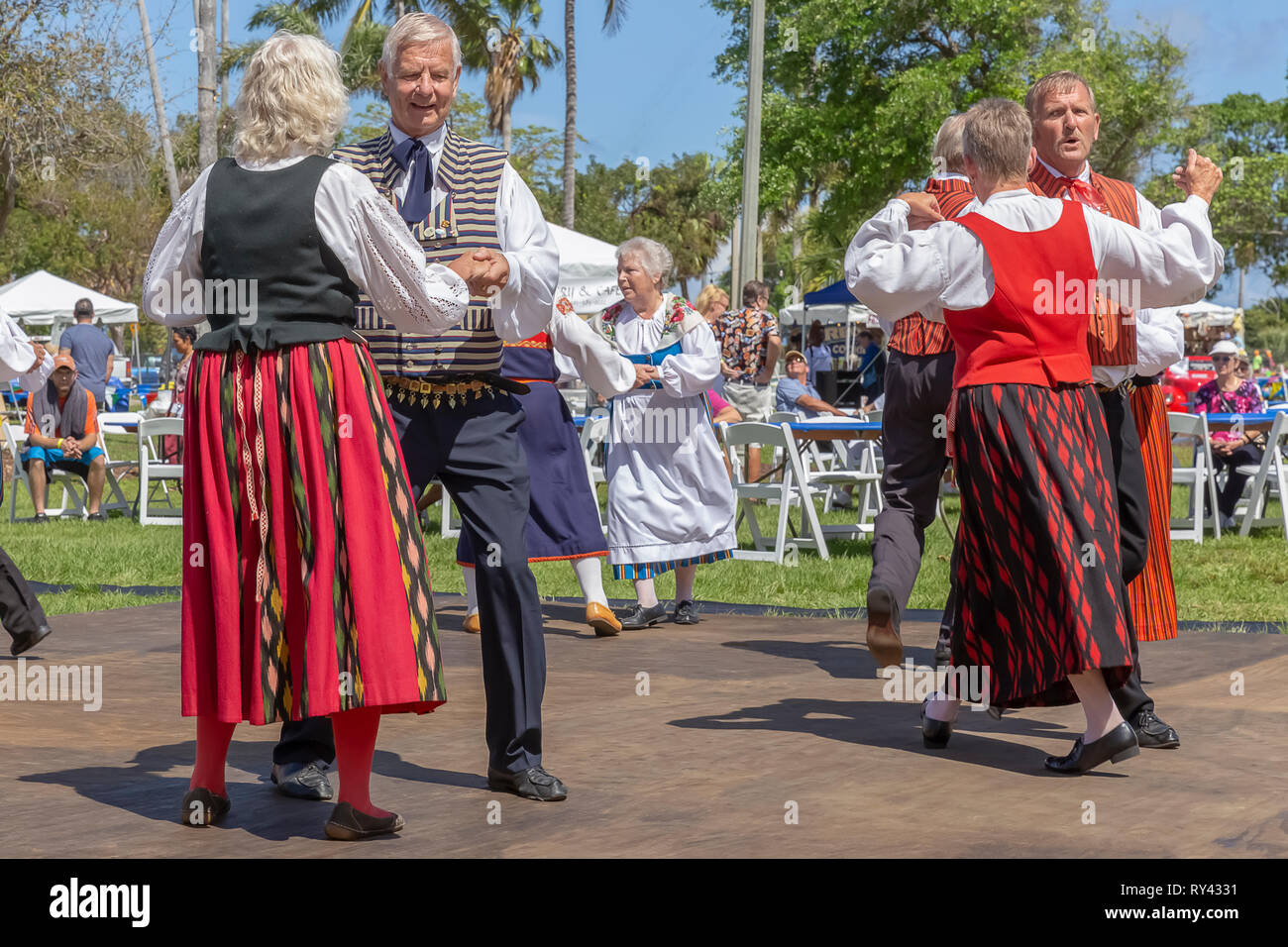 Lake Worth, Florida, USA March 3, 2019,​ Midnight Sun Festival Celebrating Finnish Culture. The men and women dance together on the outdoor dance floor. - Stock Image